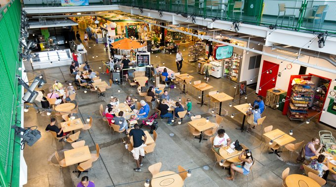 The atrium of the Flint Farmers Market functions like a town square, a place for people to shop, meet and eat.