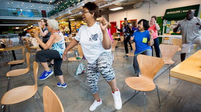 An exercise class in the Flint Farmer's Market, part of a diabetes prevention and management program.