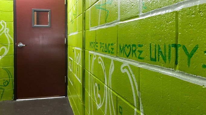 The Two Shades of Green program includes painting stairwells with vibrant murals by local artists to encourage residents to take the stairs -- a healthy and energy efficient addition to the building.