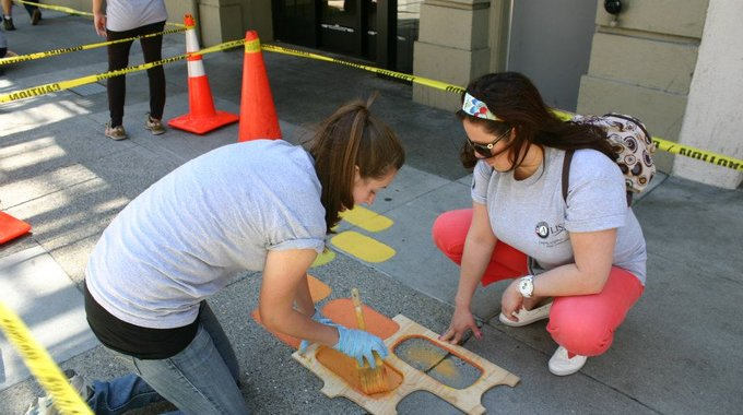 AmeriCorps members paint the route for a Safe Passage program in San Francisco's Tenderloin, an effort to help kids walk to school safely.