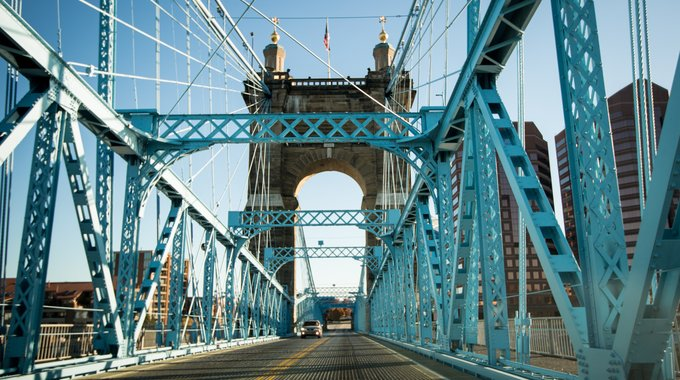 The Roebling Suspension Bridge, spanning the Ohio River from Covington to Cincinnati, was named for its designer, John Roebling, famed for building the Brooklyn Bridge. When it first opened to pedestrians in 1866, it was the longest suspension bridge in the world. Today, it is a conduit between Cincinnati's sports venues and Roebling Point, a popular restaurant and shopping district in Covington.