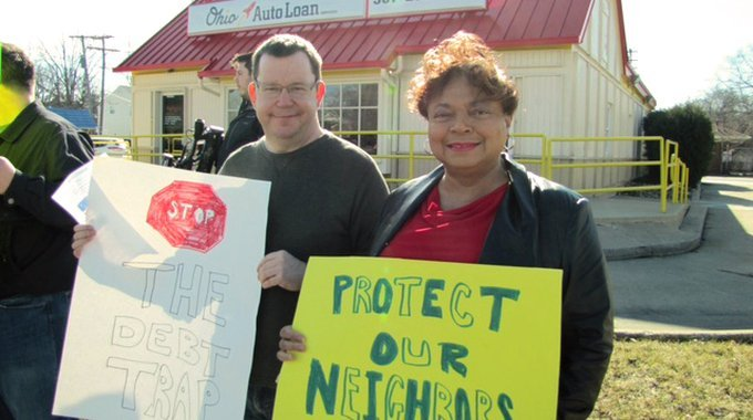 Residents protesting against predatory lending outside the Ohio Auto Loan office.