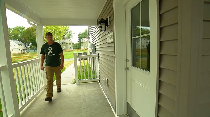 Scott Tull on the porch of his home at Perry Point Veterans Village.