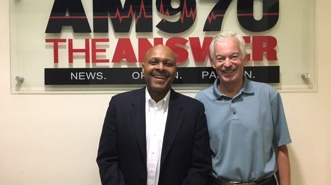 Maurice Jones, LISC CEO, with Denver Frederick, host of The Business of Giving
