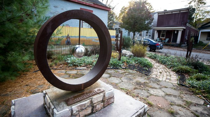 Once a vacant lot, the Farney Art Park was conceived and built by local activists and named for Henry Farney, a 19th-century Covington resident who celebrated Native American culture in his work. The circular sculpture by local artist David Rice interprets a Sioux emblem that Farney used as his signature.