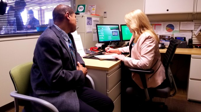 Client Stephen Combs with ProMedica FOC's Site Administrator & Financial Coach, Michelle Gorsuch.