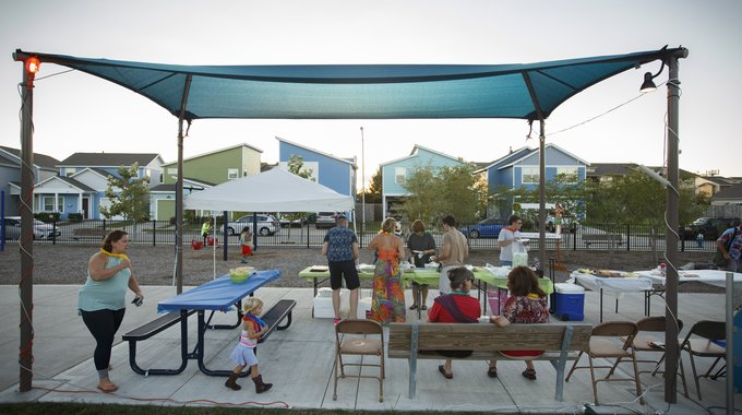 "A ""National Night Out"" gathering getting underway at Avenue Place, a new complex of affordable, single-family homes for purchase developed by Avenue CDC. To date, Avenue has built 143 single-family homes in Near Northside, as well as 203 apartments. Another 39 houses and 156 apartments are currently in the works."