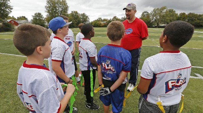A coach works with youth players at Mulroy Field in South Buffalo
