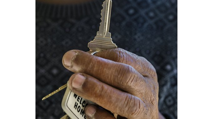 Army veteran Jimmie with the keys to his apartment at Willow Housing in Menlo Park, CA.