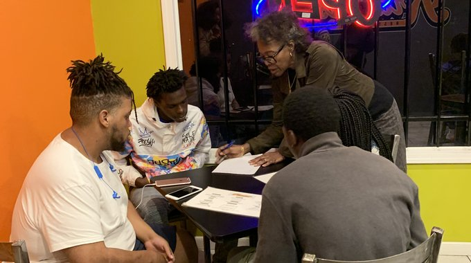 Apprentices fill out a self-assessment with Dr. Pamela Saulsberry, director of the school of behavioral and social science at  the University of Louisiana-Monroe, and a coordinator of the apprenticeship program.