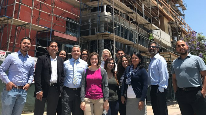 Cielito Lindo is an affordable housing community developed by East L.A. Community Corp. Antonio Ramon (pictured, in tie, with the real estate team), just completed the HDTI training that helped him manage the project. Photo courtesy of Antonio Ramon.