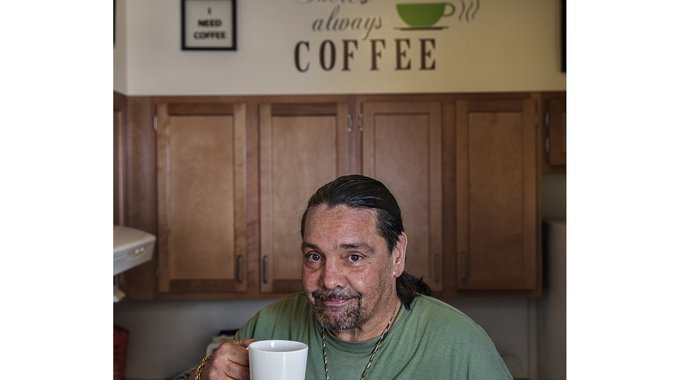 Army veteran Pasquale takes a coffee break at his Liberty Landing apartment in Ronkonkoma, NY.