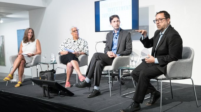 Laura Callanan of Upstart Co-Lab, Janet Rodriquez of SoHarlem, David Ehrenberg of the Brooklyn Navy Yard Development Corporation and Sam Marks of LISC NYC speaking about the inclusive creative economy at Phillips auction house in June. Photo by Charles Chessler.