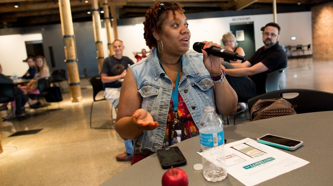 Flint native Tamika Cordell addresses a meeting of the University Avenue Corridor Coalition. She first got involved with crime reduction efforts along the corridor through her neighborhood's Facebook page