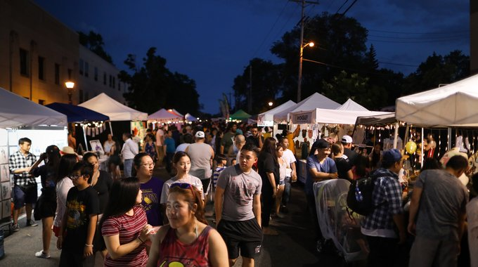 The Little Mekong Night Market in St. Paul continues to draw a crowd well into the evening.