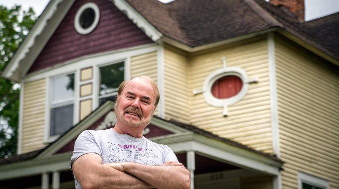 Gerry Hoffman in front of the Queen Anne home his parents bought in the early 1960s, when jobs in Kalamazoo's then-robust economy were plentiful. Hoffman has volunteered with the Edison Neighborhood Association since its inception.