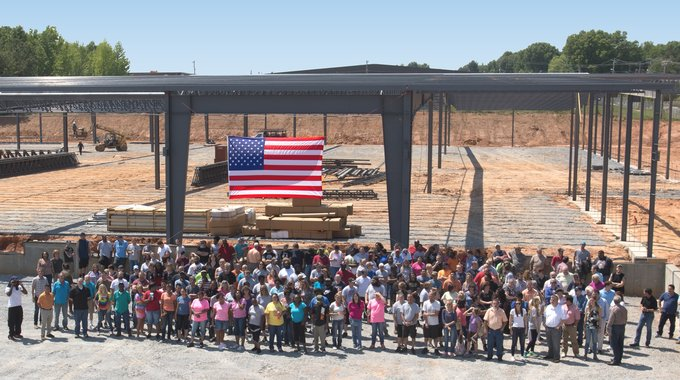 Employees stand in front of the beginnings of the new Revolution Fabric plant in Kings Mountain, NC, which is now fully operational and employs more than 450 people.
