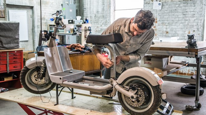 Assembling a scooter at Fido Motors and Cafe, part of a complex of repurposed industrial buildings in Edison that also house an auto mechanic, a welder, an electrician and the Kal-Tone Musical Instrument Co.