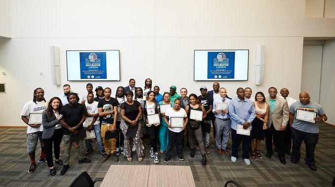 Orians and other First 72+ staff members celebrate with 24 formerly incarcerated entrepreneurs who were  inducted into the small business incubator program.