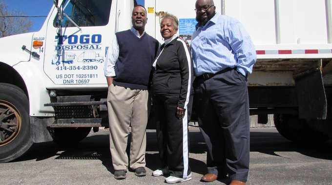 From left, Cory, Norma and Terrance Guy, owners of ToGo Disposal in Milwaukee. The family-owned business is growing thanks to a loan from LISC and the Wisconsin Housing and Economic Development Authority.